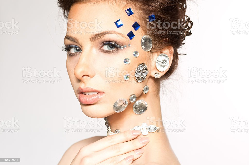 portrait of beautiful girl with diamonds on her face royalty-free stock photo