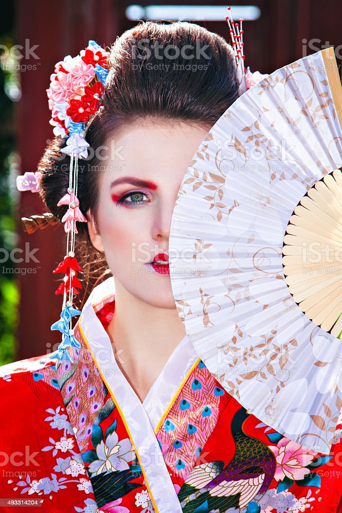 Portrait of beautiful girl with fancy geisha makeup stock photo