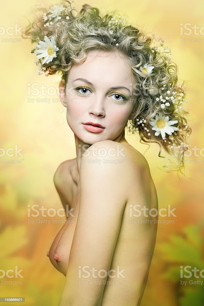 portrait of beautiful girl with flowers in their hair royalty-free stock photo