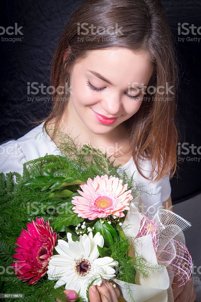 Portrait of beautiful girl with flowers royalty-free stock photo