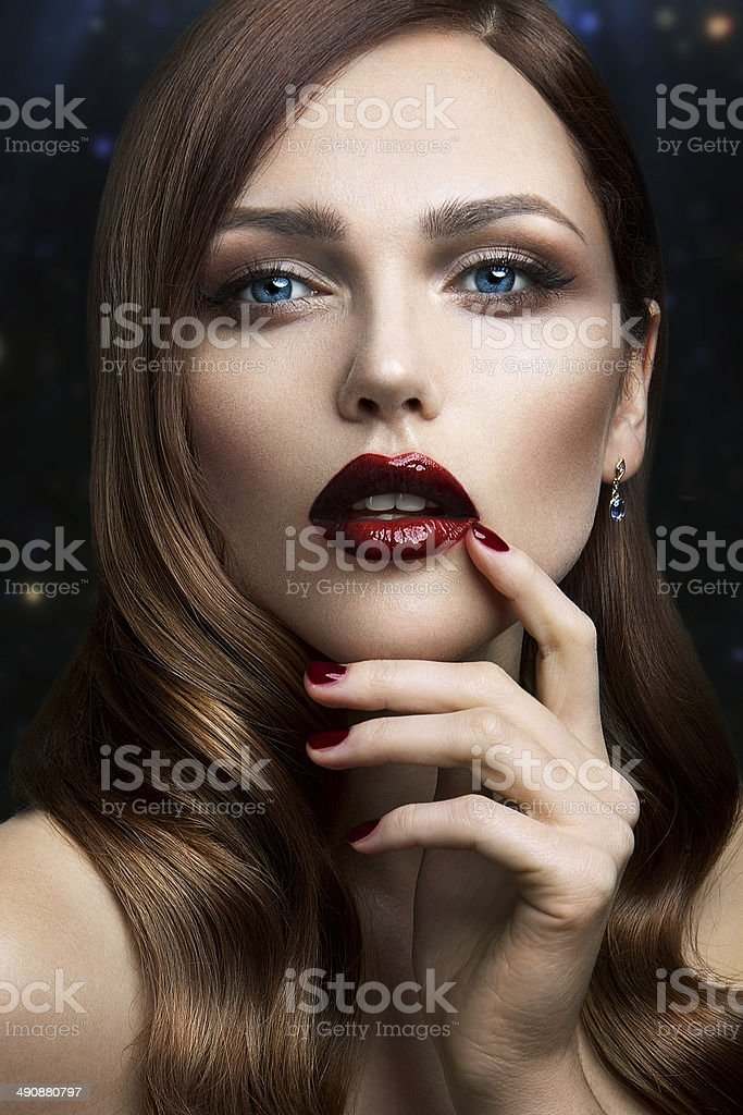 Portrait of beautiful girl with red lips. stock photo