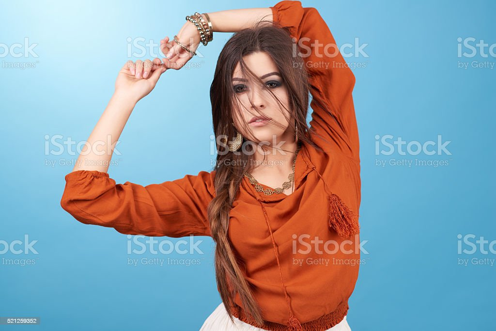 Portrait of beautiful glamor hipster young hippie woman in studio. stock photo