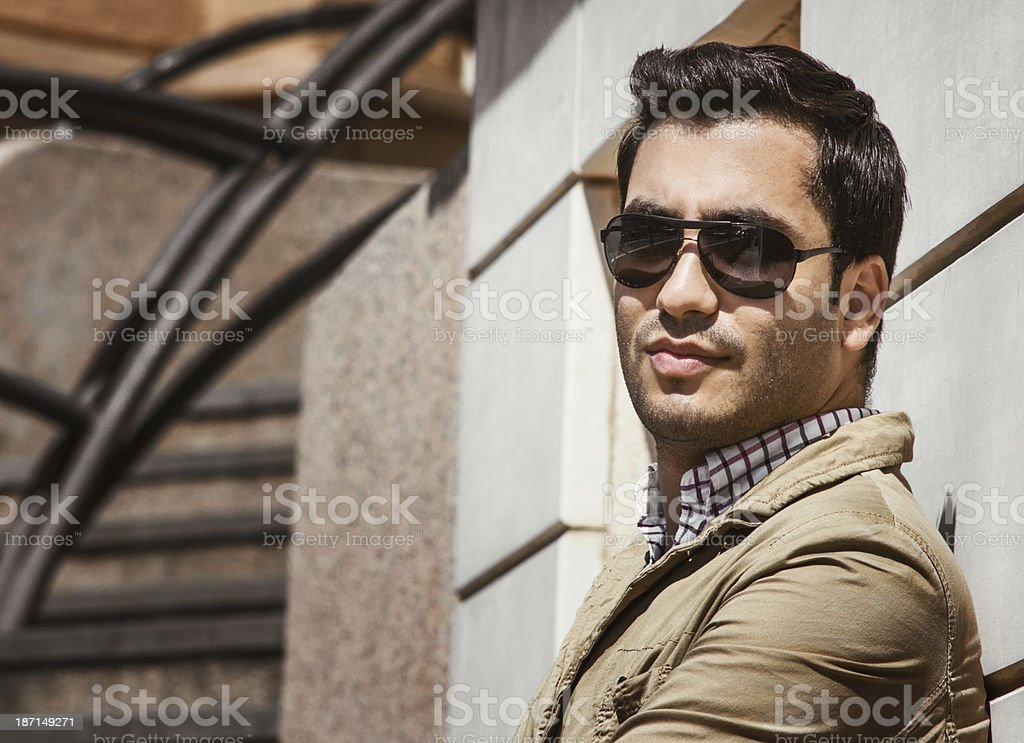Portrait of beautiful guy with sunglasses stock photo