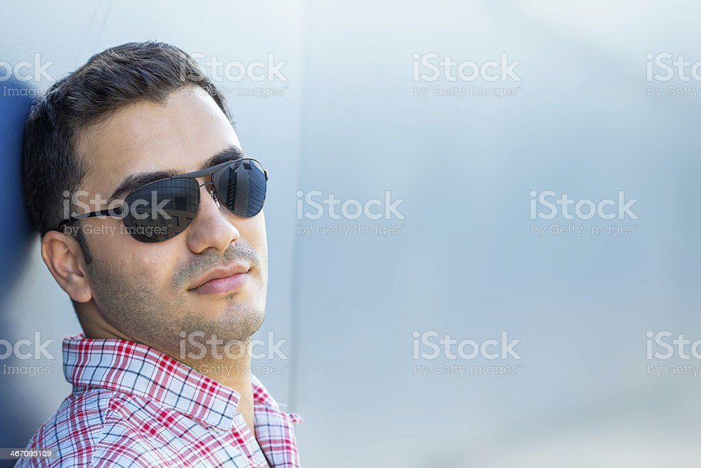 Portrait of beautiful guy with sunglasses royalty-free stock photo