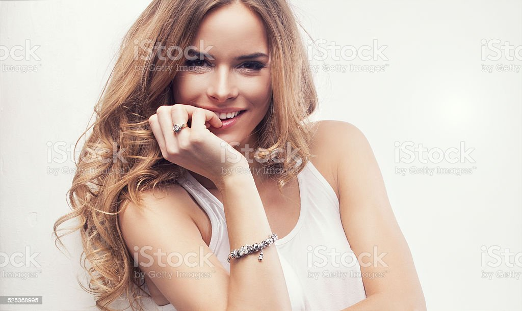 Portrait of beautiful happy blonde woman stock photo