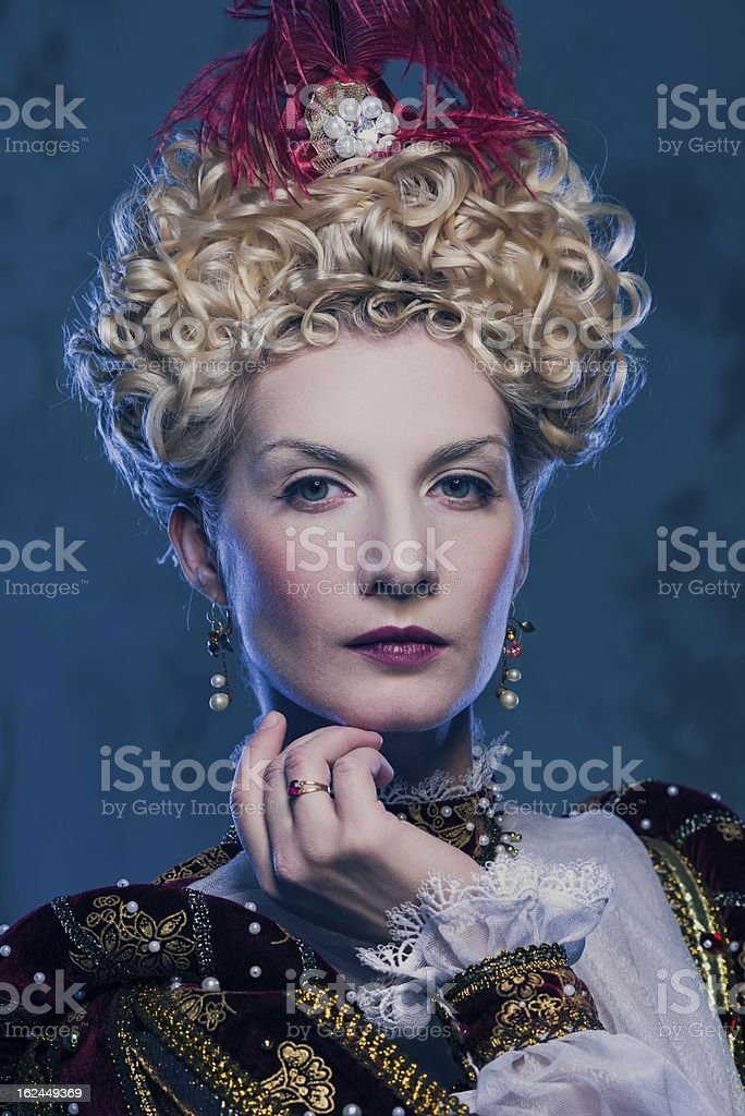 Portrait of beautiful haughty queen royalty-free stock photo