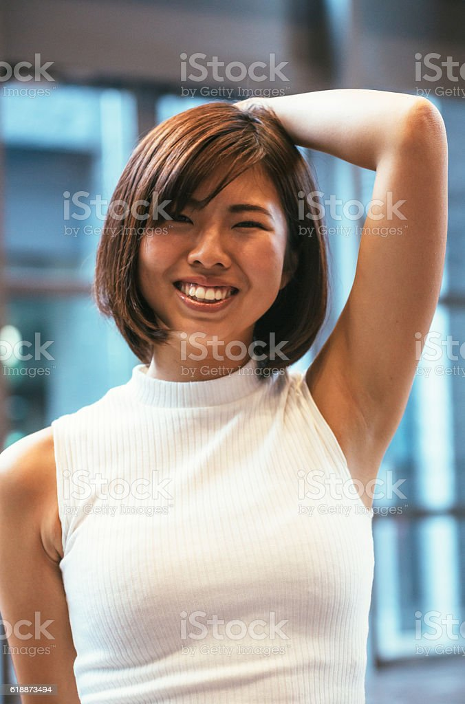 Portrait of beautiful Japanese young woman indoors stock photo