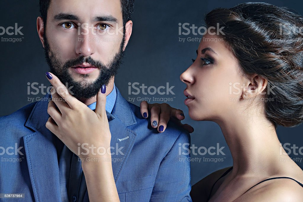 Portrait of beautiful lady with handsome guy in suit stock photo
