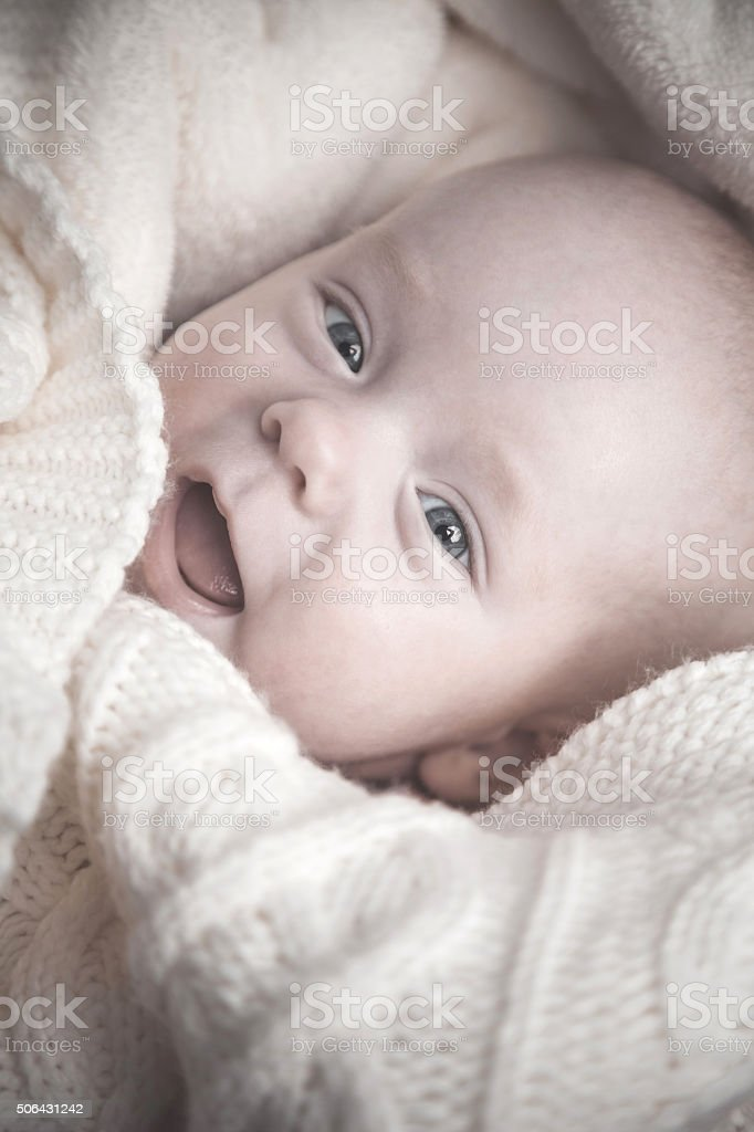 Portrait of beautiful little baby looking at camera and laughing stock photo
