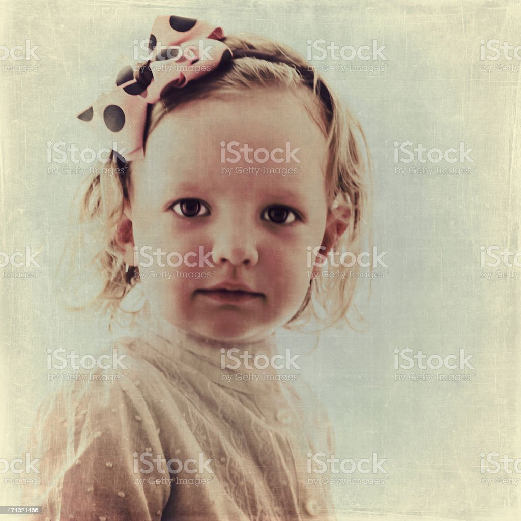 Portrait of beautiful little girl in vintage style. stock photo
