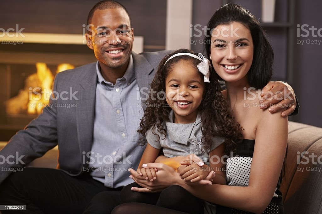 Portrait of beautiful mixed race family at home royalty-free stock photo