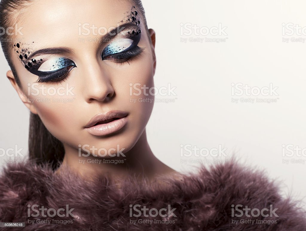 portrait of beautiful model with bright eyes makeup stock photo