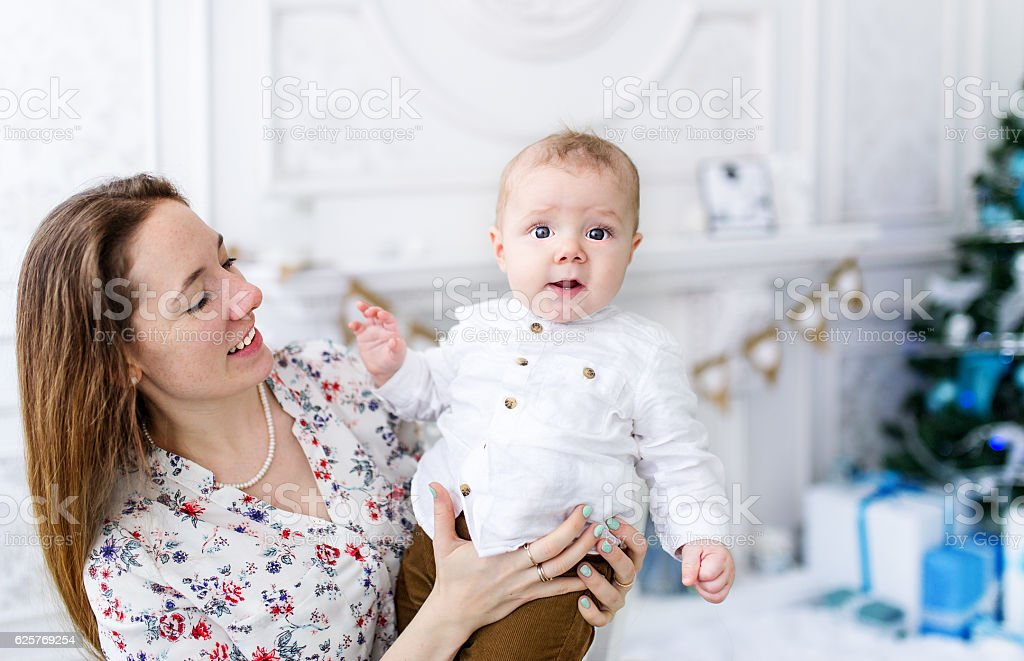 Portrait of beautiful mother and baby son stock photo