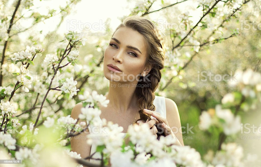 Portrait of beautiful natural woman make hair braid stock photo