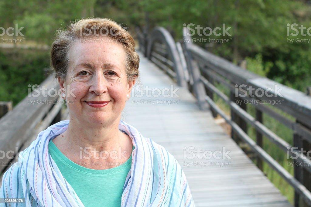 Portrait of beautiful older woman smiling stock photo
