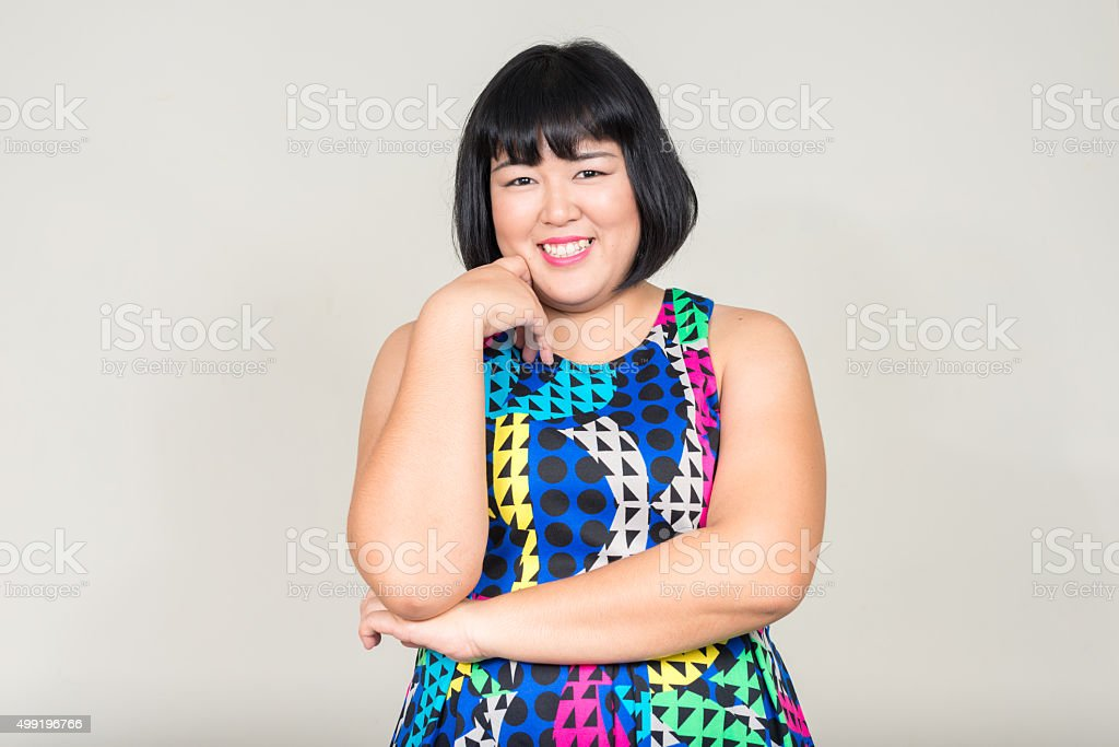 Portrait of beautiful overweight Asian woman stock photo