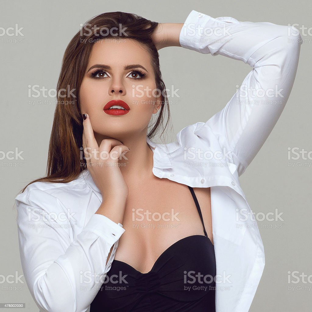 Portrait of beautiful plus size curly young woman stock photo