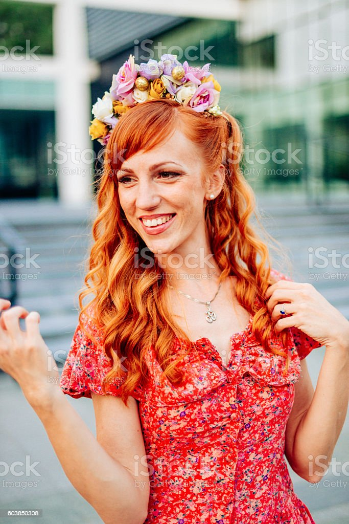 Portrait of beautiful red head woman with hair accessory stock photo