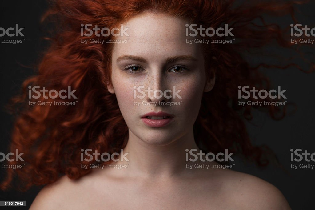 Portrait of beautiful redhead fashion model stock photo