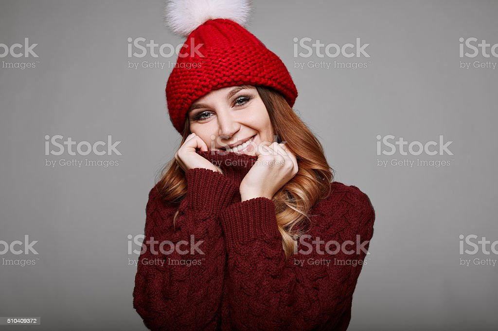 Portrait of beautiful redhead woman in sweater stock photo