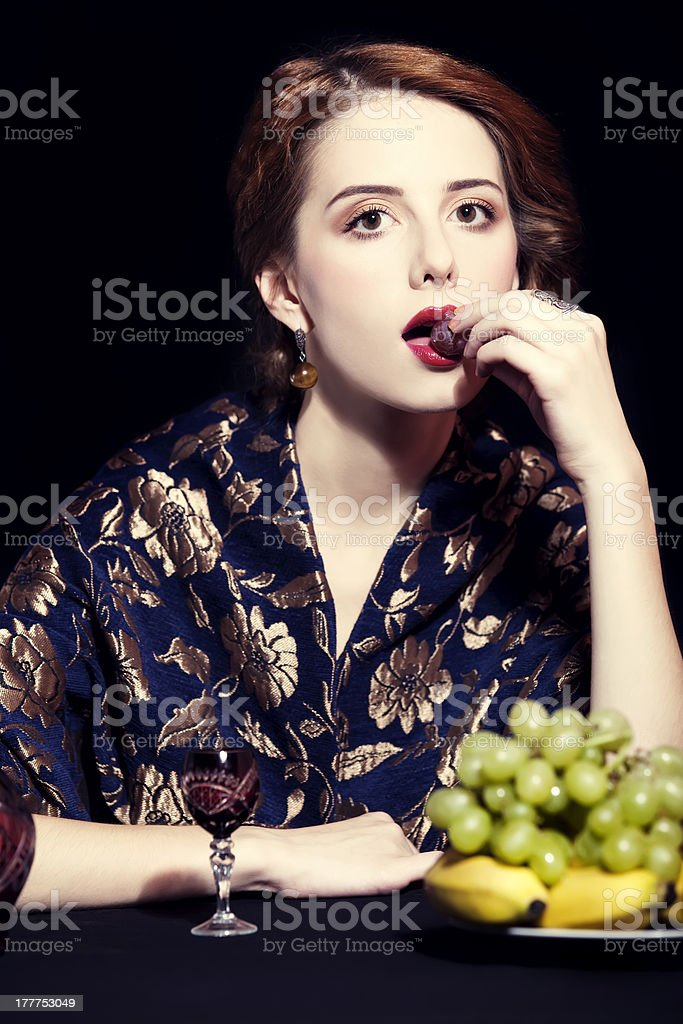 Portrait of beautiful rich women with grapes. royalty-free stock photo