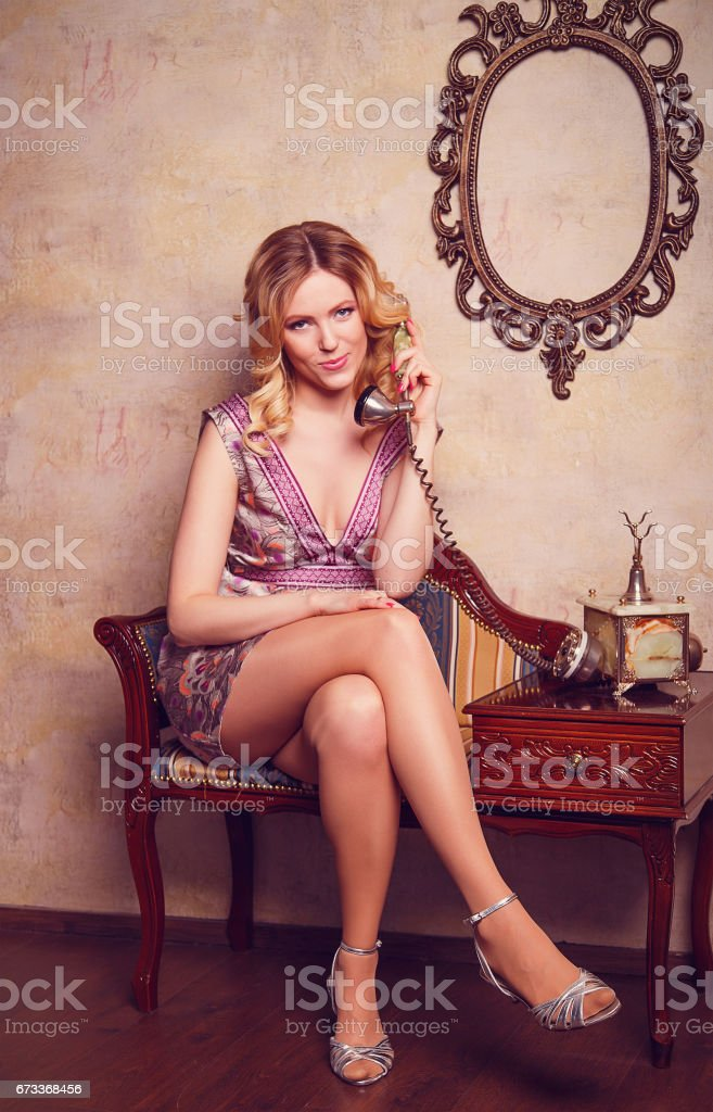 Portrait of beautiful sensual young lady with stylish phone stock photo