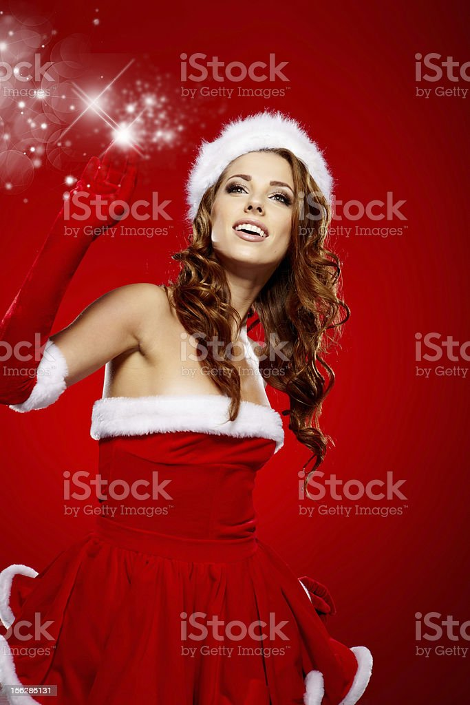 Portrait of beautiful sexy girl wearing santa claus clothes royalty-free stock photo