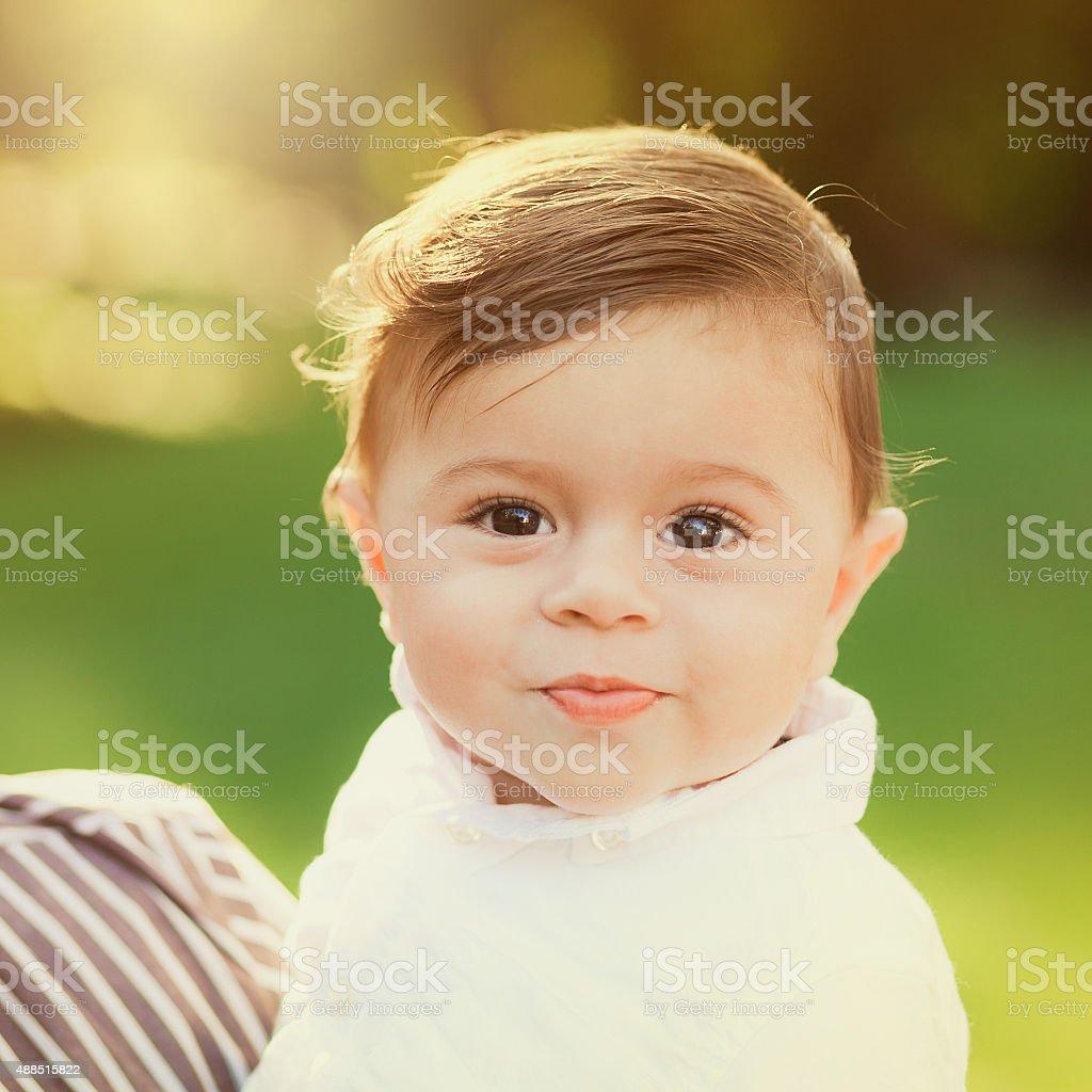 Portrait of beautiful smiling cute baby boy stock photo