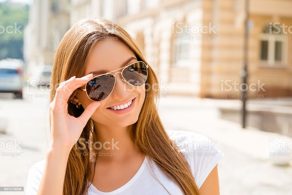 Portrait of beautiful smiling girl in glasses enjoying summer day stock photo