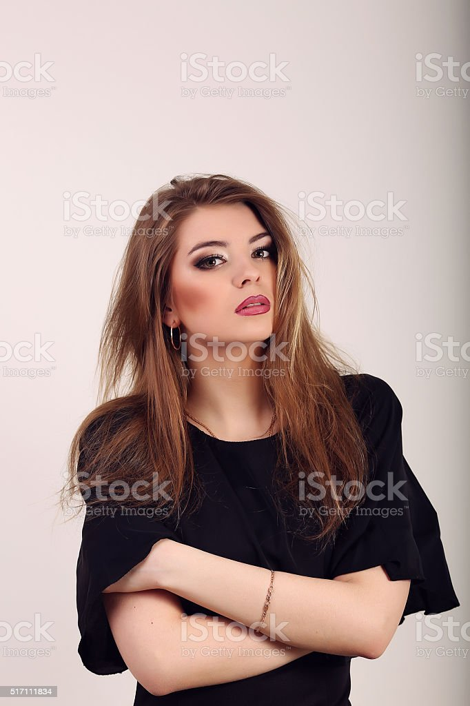 Portrait of beautiful smiling woman isolated on beige with copys royalty-free stock photo