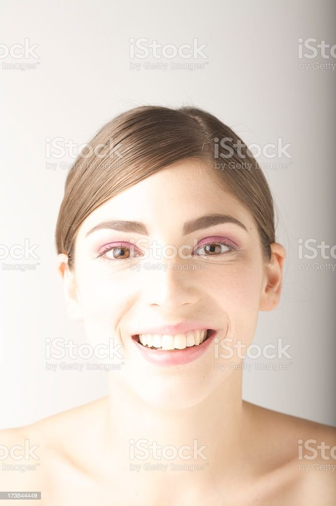 Portrait of beautiful smiling young woman stock photo