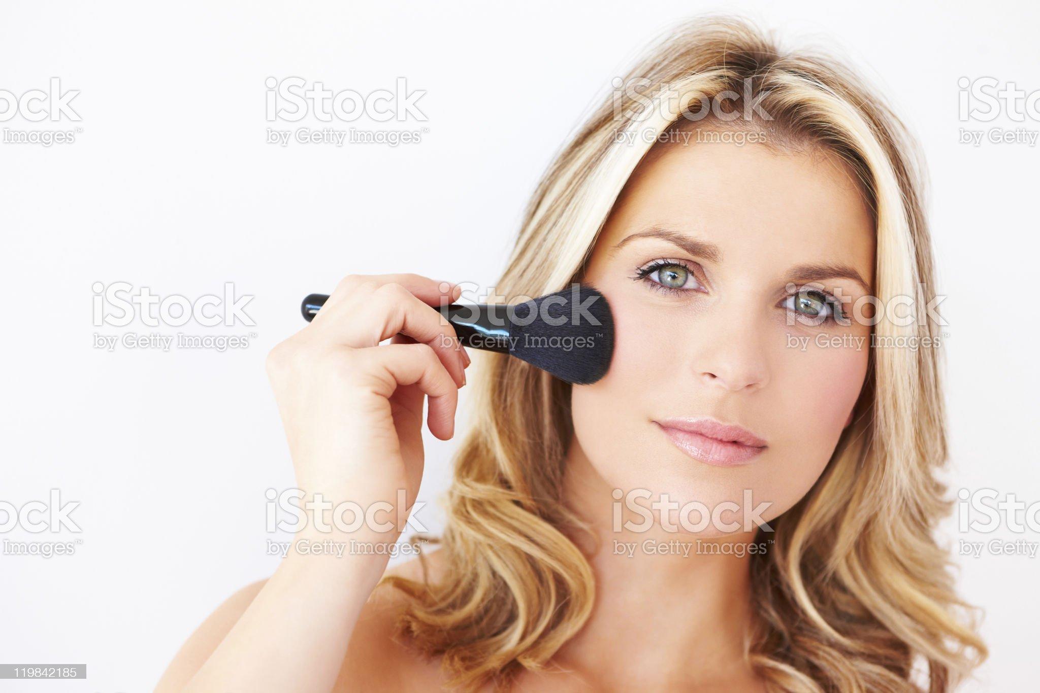 portrait of beautiful woman applying makeup royalty-free stock photo