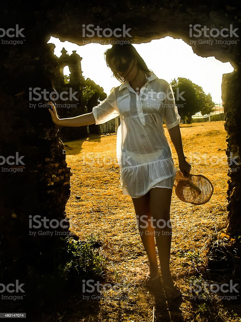 Portrait of Beautiful Woman Dressed in Transparent White Dress stock photo