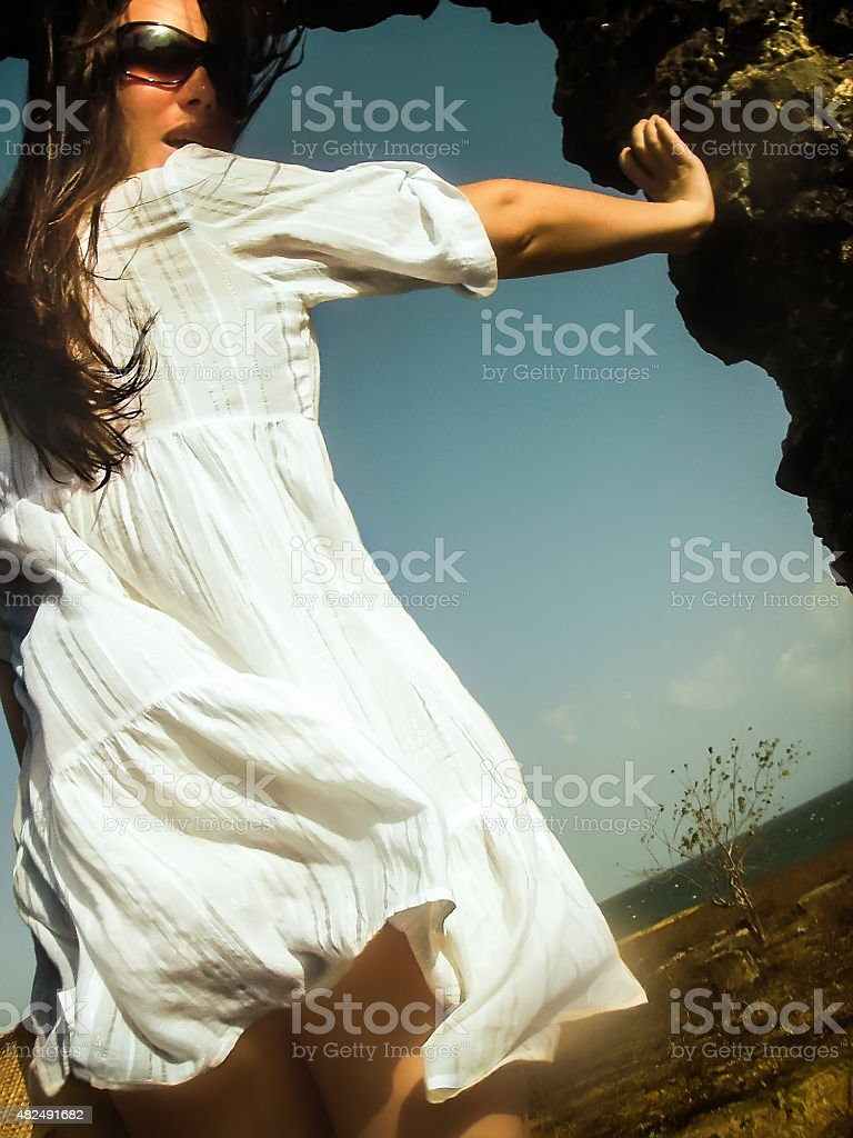 Portrait of Beautiful Woman Dressed in White Dress stock photo