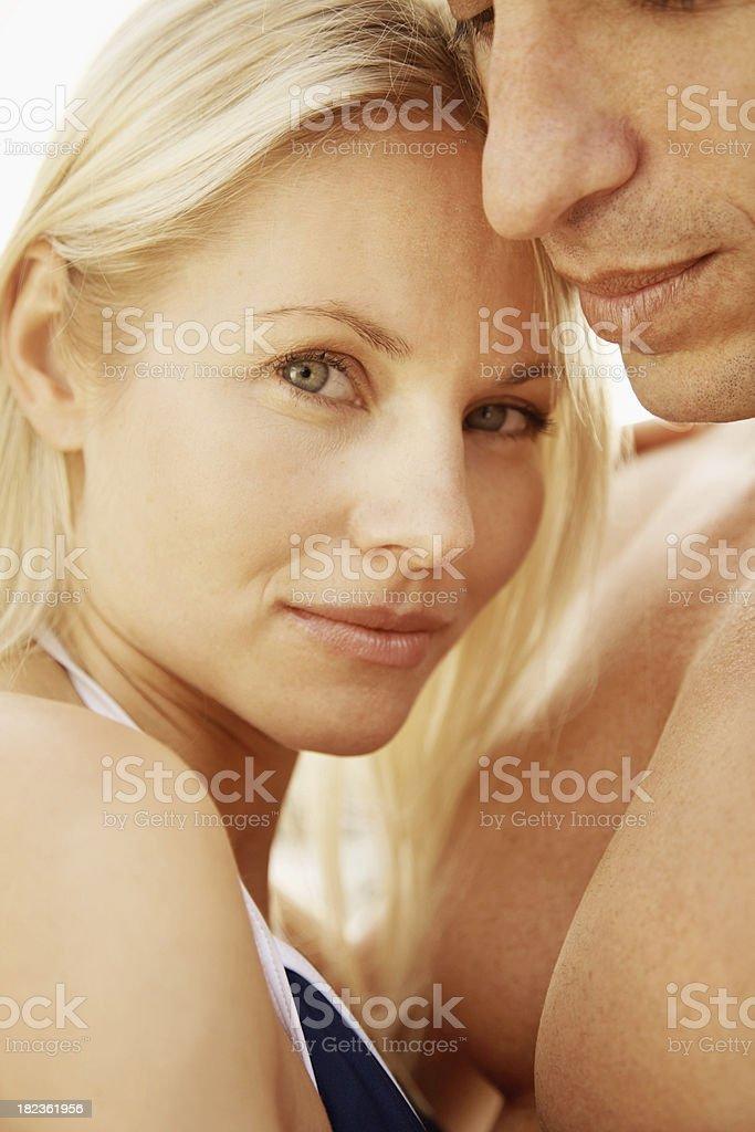 Portrait of beautiful woman embracing her husband royalty-free stock photo