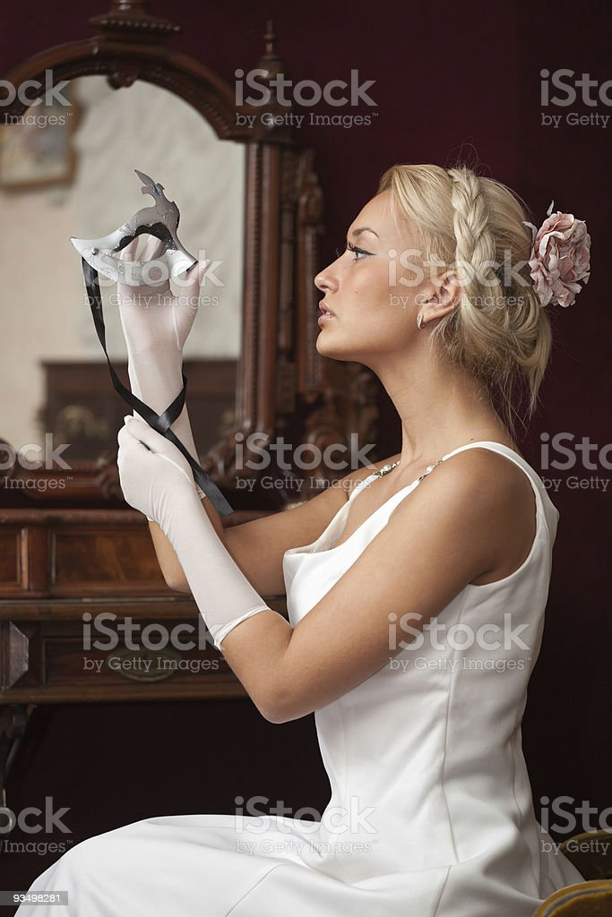 Portrait of beautiful woman holding venetian carnival mask royalty-free stock photo