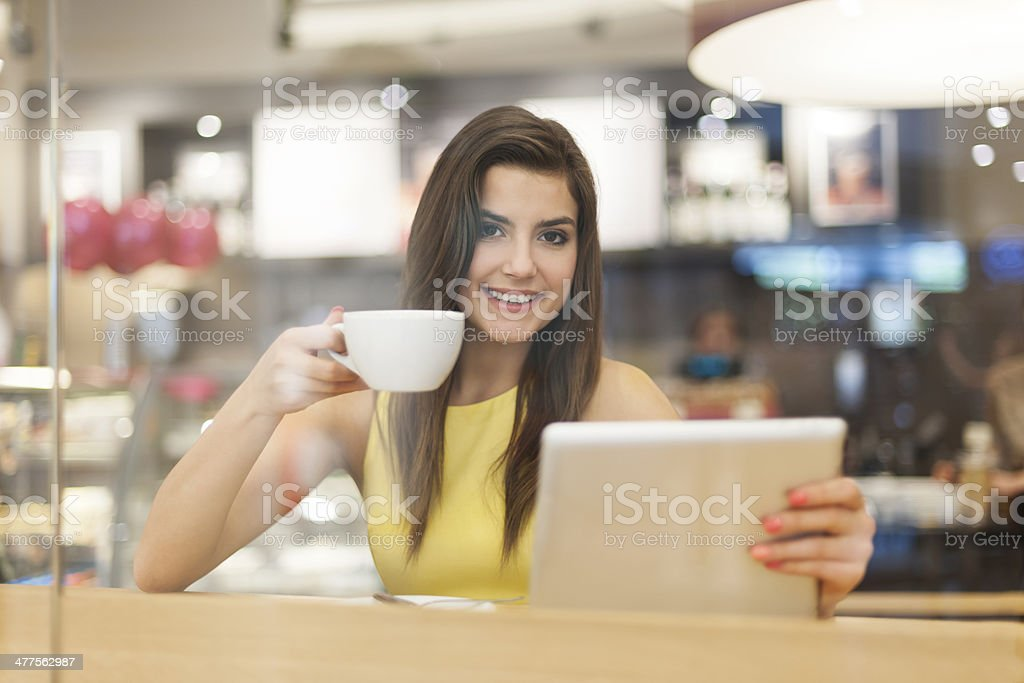 Portrait of beautiful woman in cafe with digital tablet royalty-free stock photo