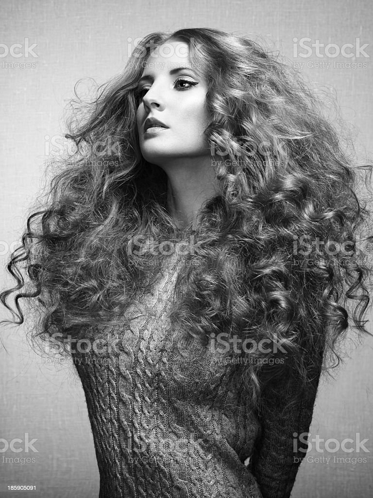 Portrait of beautiful woman in knitted dress royalty-free stock photo