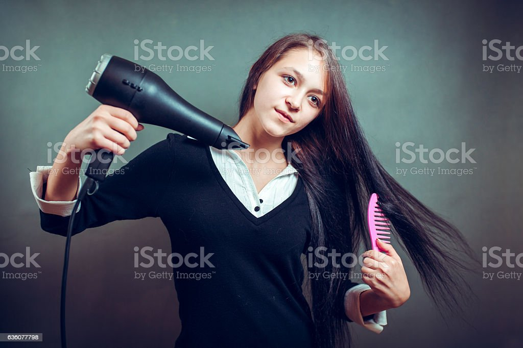 Portrait of beautiful woman, she holding hair dryer stock photo