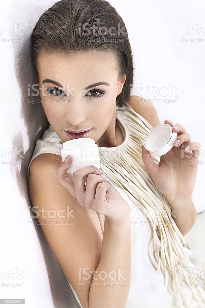 Portrait of beautiful woman with cream stock photo
