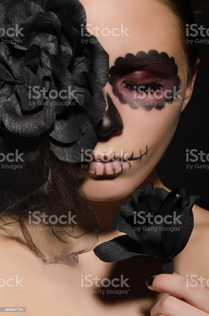 portrait of beautiful woman with face art and flower stock photo