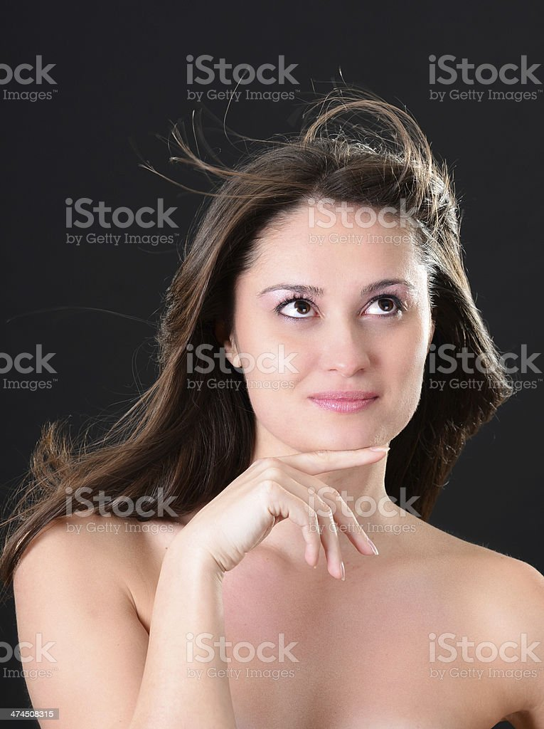 Portrait of beautiful woman with flying hair and smooth skin royalty-free stock photo