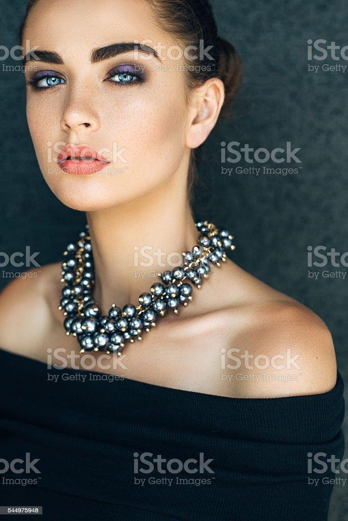 Portrait of beautiful woman with jewelry stock photo