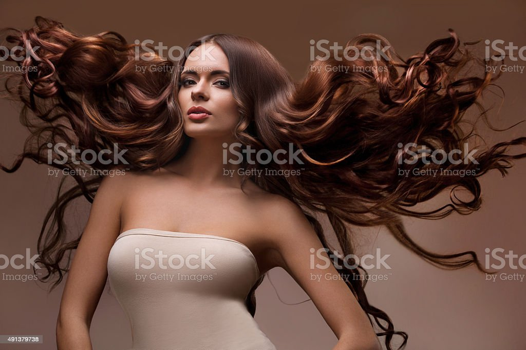 Portrait of Beautiful Woman with Long flying Hair. stock photo
