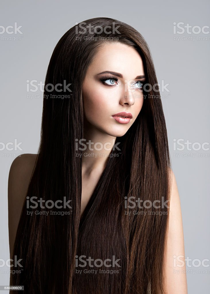 Portrait of beautiful woman with long straight brown hair stock photo