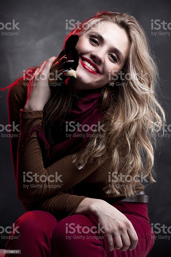 Portrait of beautiful woman with makeup brushes royalty-free stock photo