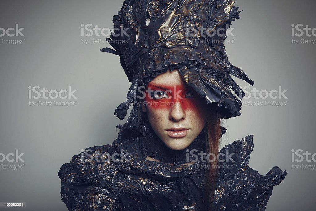 Portrait of beautiful woman with metal headwear and red make-up stock photo