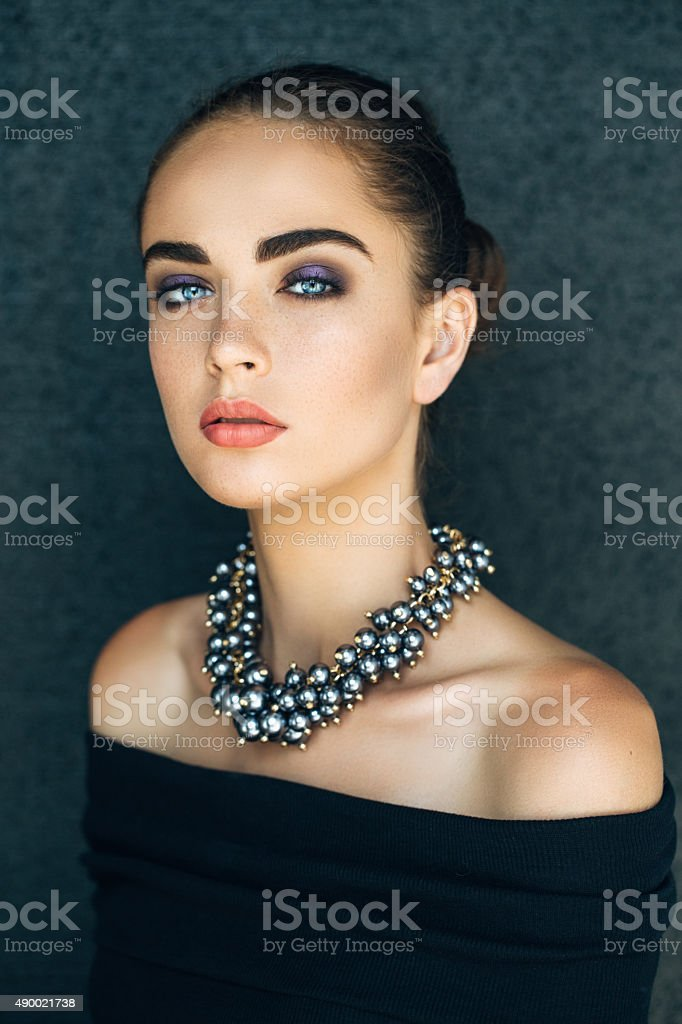 Portrait of beautiful woman with necklace stock photo