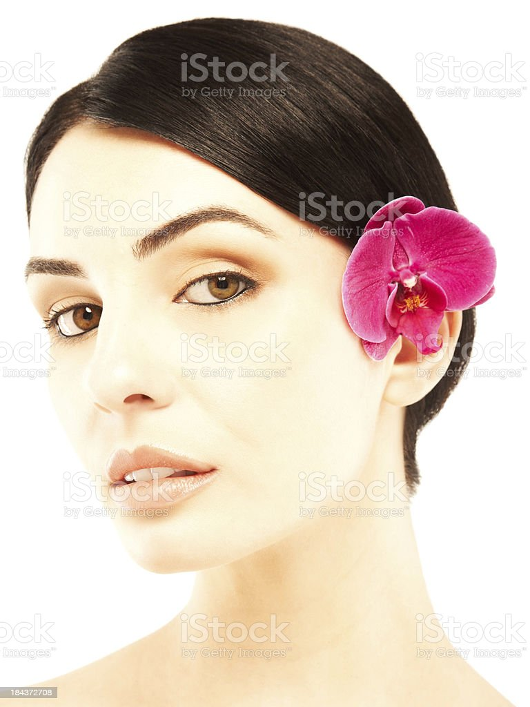 Portrait of beautiful woman with pink orchid flower stock photo