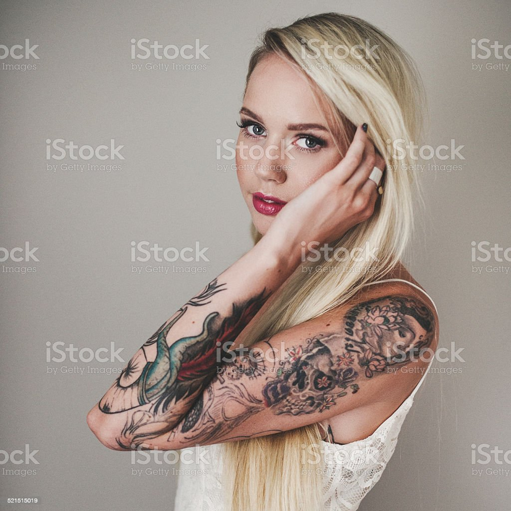 Portrait of beautiful woman with tattoes stock photo